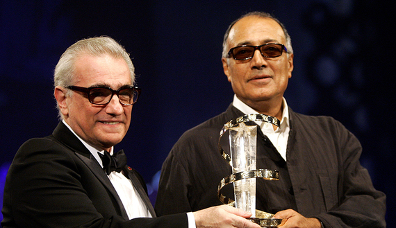 Iranian director Abbas Kiarostami (R) receives an award from U.S. director Martin Scorsese during the closing ceremony of the 5th Marrakesh International Film Festival in Marrakesh, Morocco, November 19, 2005. REUTERS/Andrea Comas/File Photo - RTX2JPDJ